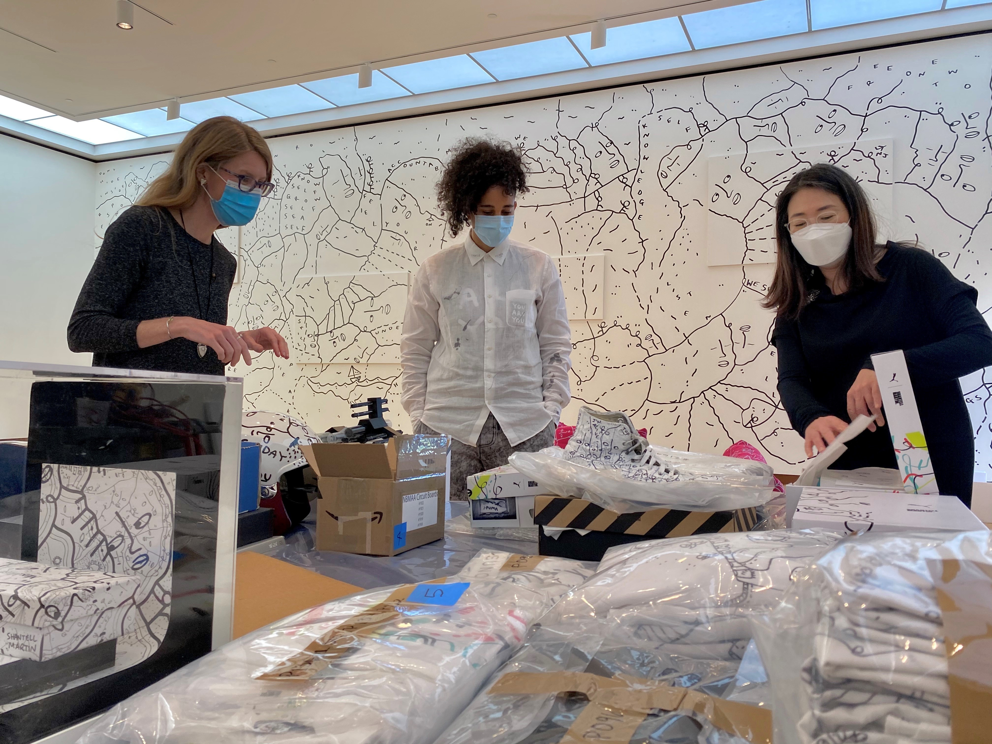 Pictured: Lisa Williams (left), during the install of <i>NEW/NOW: Shantell Martin </i>