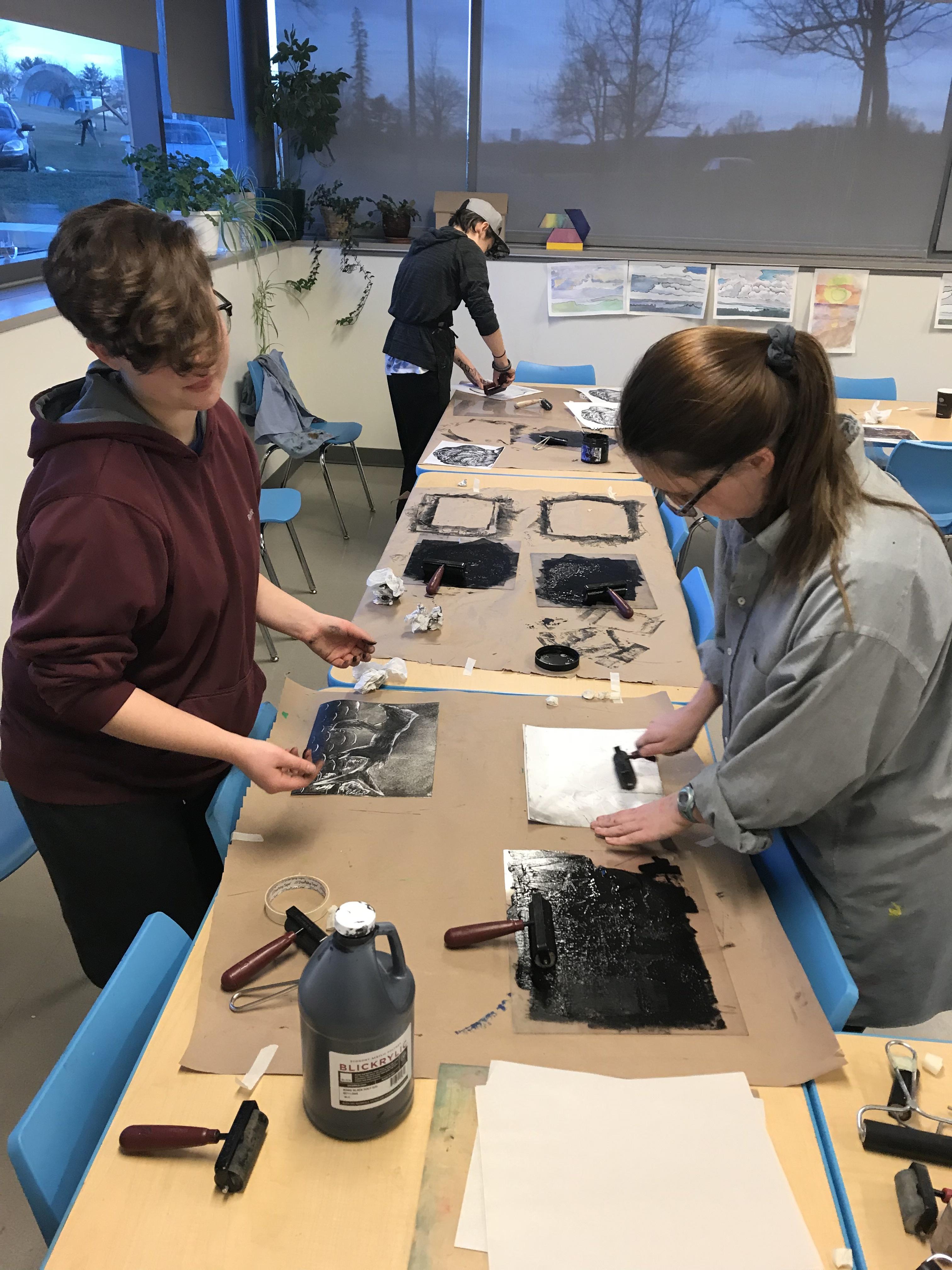 Students creating monotype prints in the studio