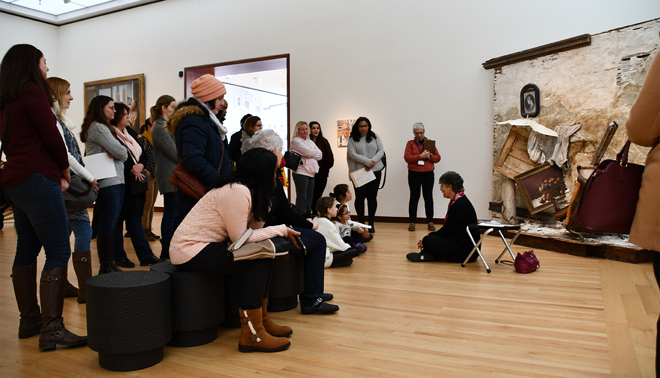 "A Museum docent speaks in front of Titus Kaphar's ""Umbrella Wall #2 (The Vesper Project)"""