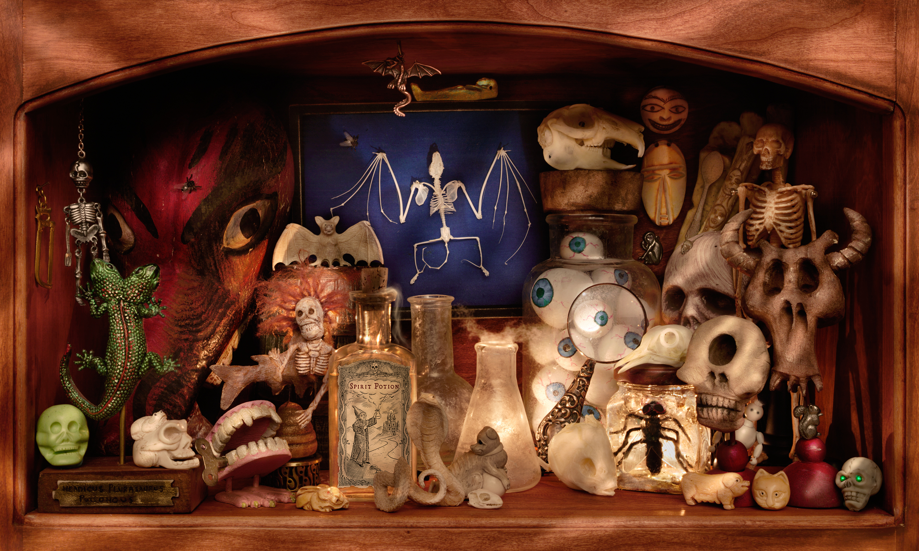 Walter Wick, <i>On A Scary Scary Shelf from Can You See What I See? On A Scary Scary Night</i>, 2007, Pigmented inkjet photograph, 50 x 30 in., Gift of Walter Wick and Linda Cheverton Wick, 2015.116.12LIC
